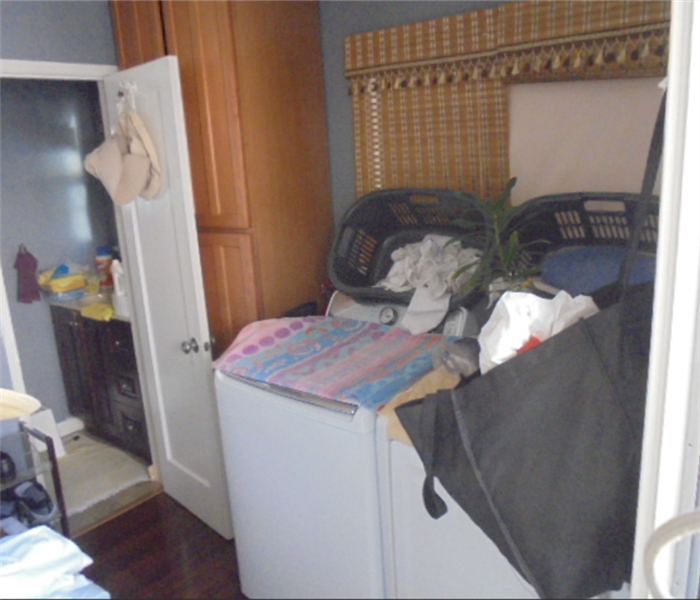 this image shows a laundry room with contents