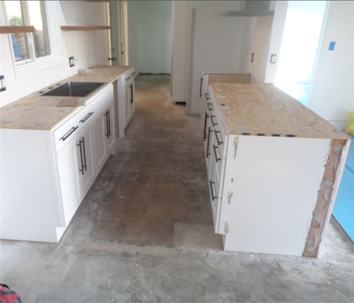 this image shows a kitchen with cabinets