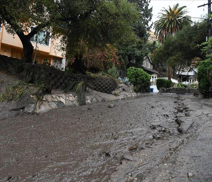 the image shows mud running down a street