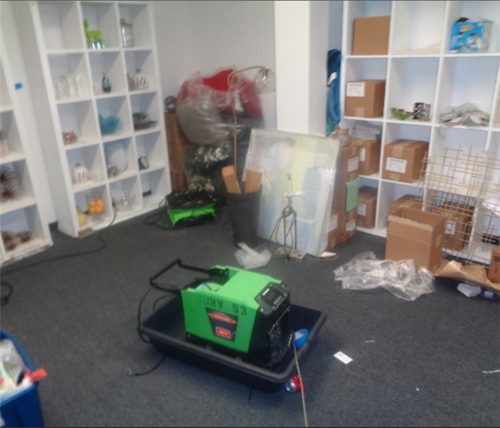 A room is shown with SERVPRO equipment