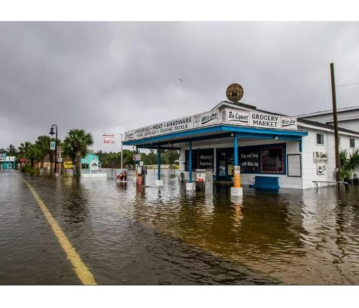 The photo shows  a flooded grocery mart