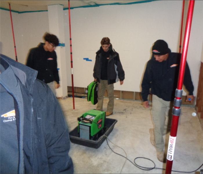 Photo shows SERVPRO crew setting up drying equipment