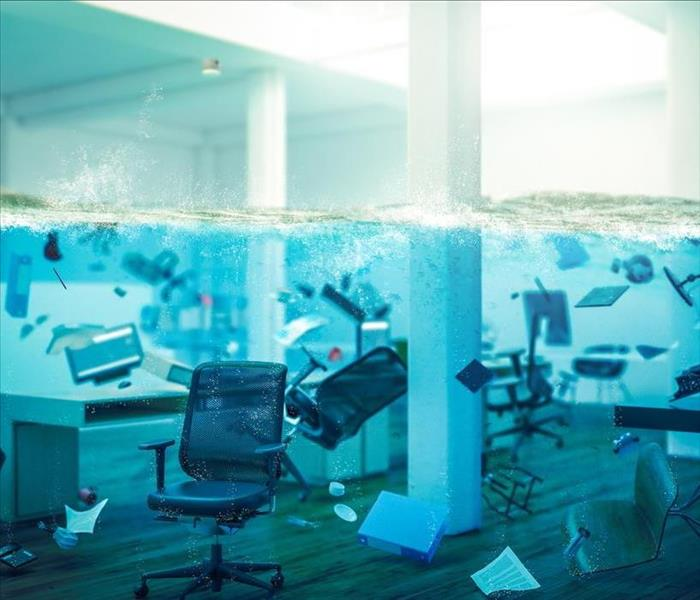 flooded out office of cubicles with furniture floating.