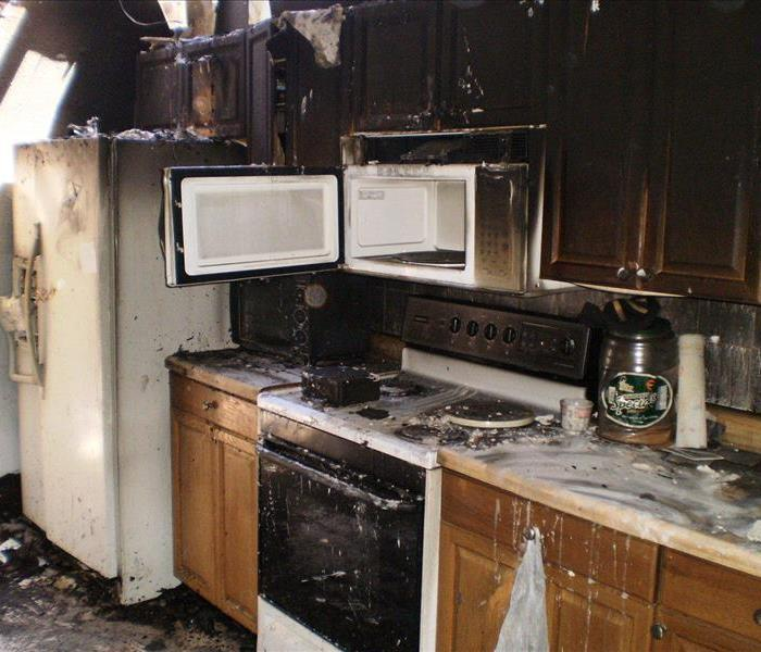 The fire damage of a grease fire is shown